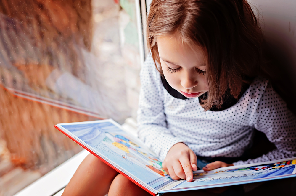 girl is reading a book
