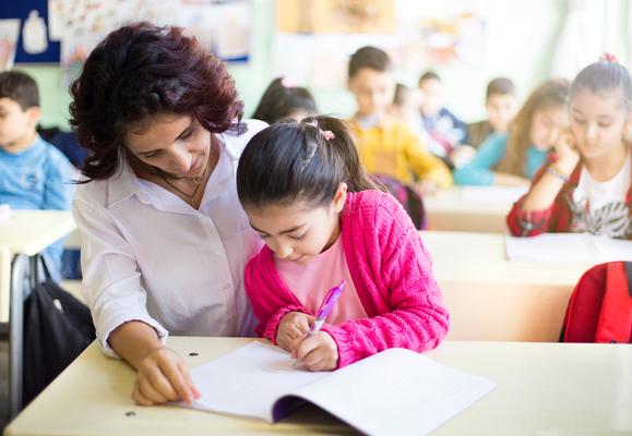 a girl with a teacher at classroom