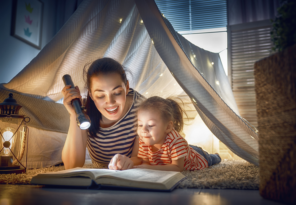 mom and kid reading a book