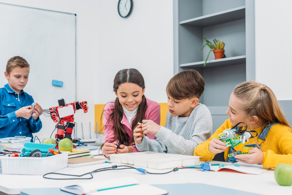 kids making a robot in the classroom