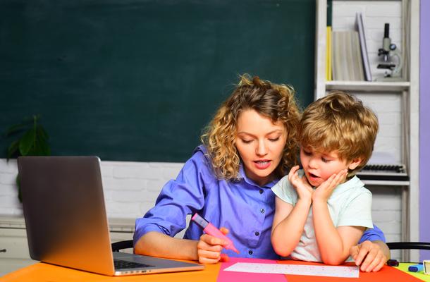 teacher and a kid doing math