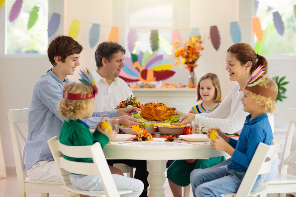 family dining together with turkey