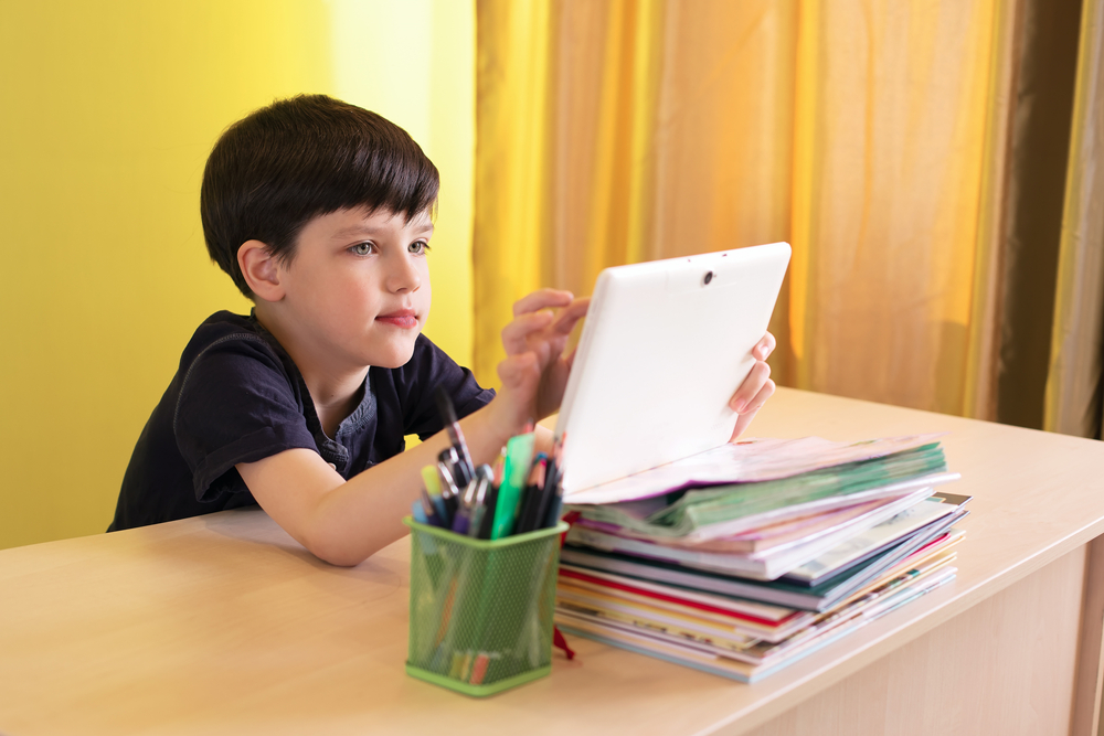 a boy with a tablet