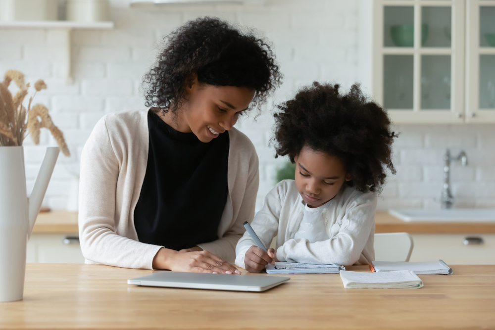 mom with daughter making homework