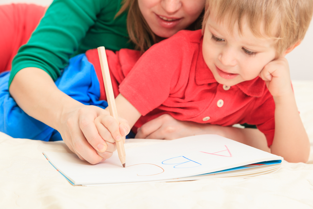 mom teches her son to write