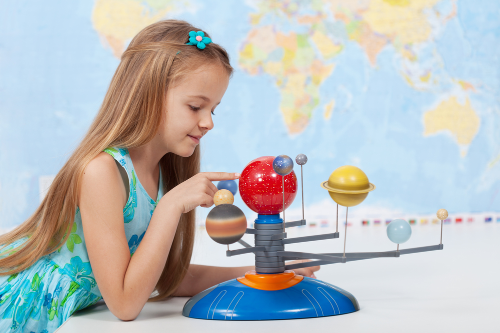 a girl with a solar system
