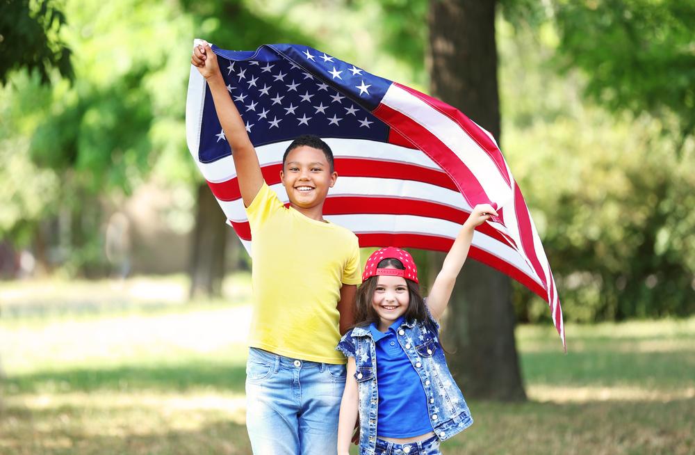 a boy with a flag