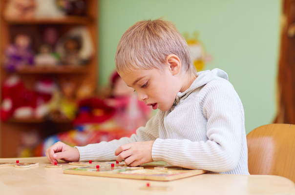 a boy with autism playing