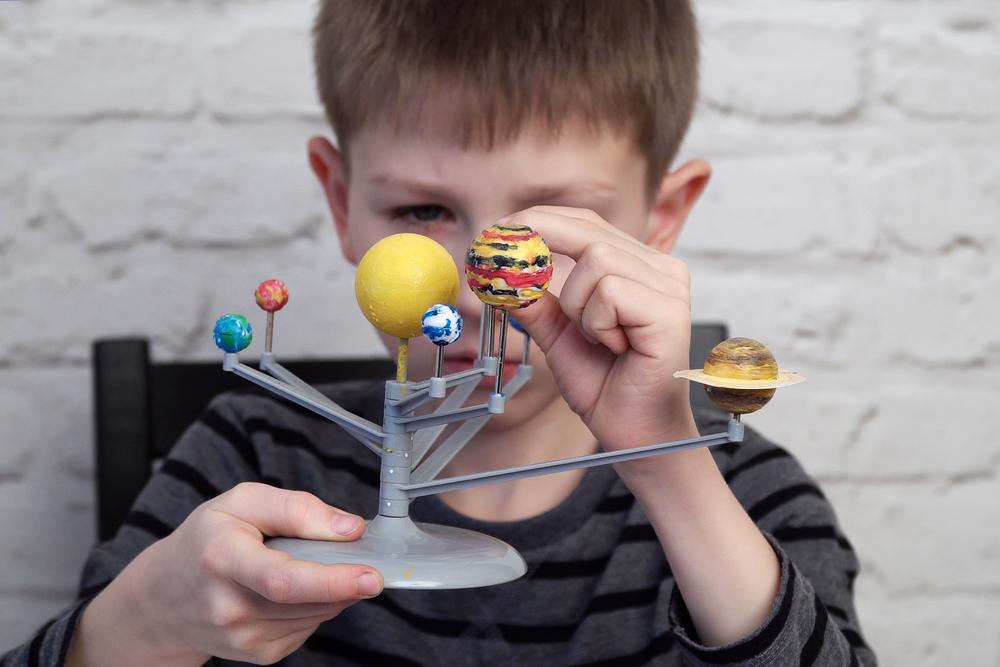 a boy with a solar system