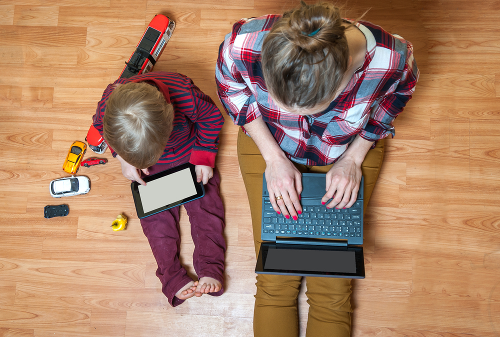 a kid with a laptop and mom