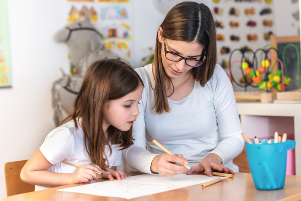 a girl and a teacher in classroom