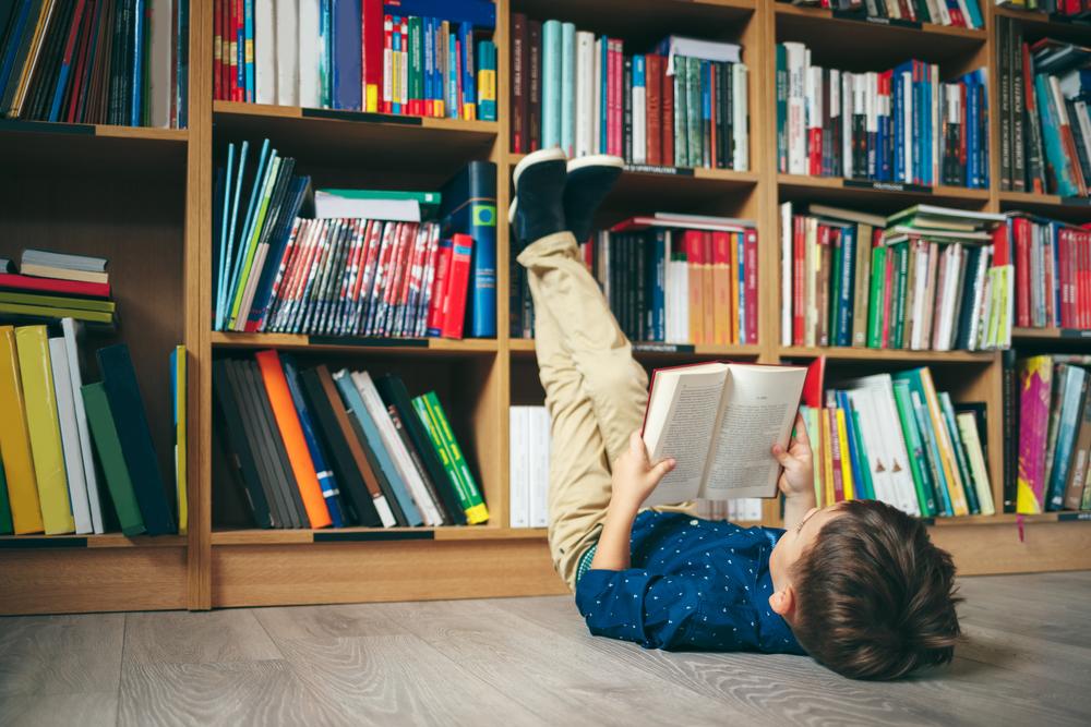a boy on the floor with a book