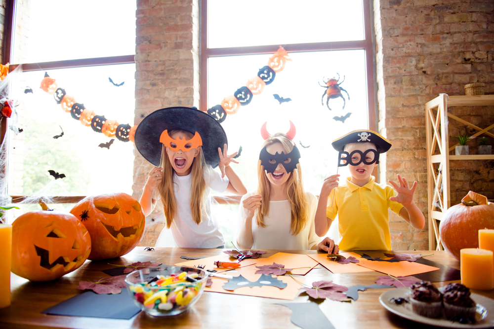 children preparing for halloween
