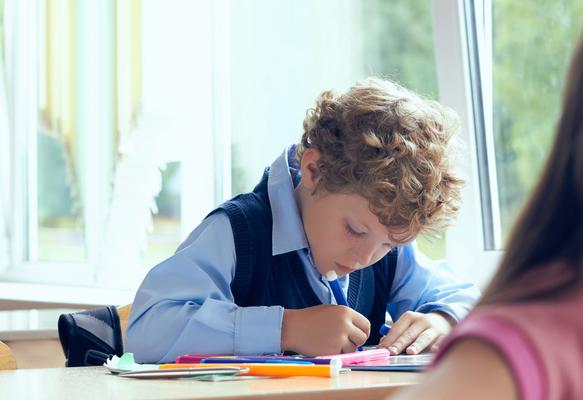 a boy is writing