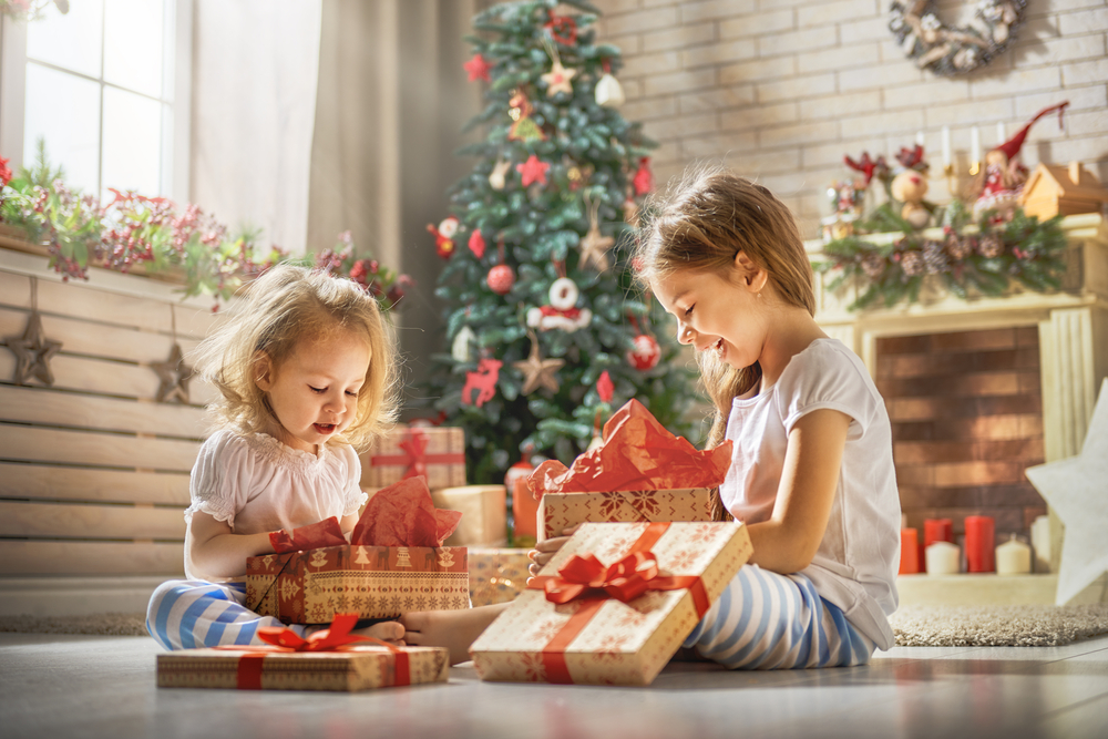 kids are playing with gifts